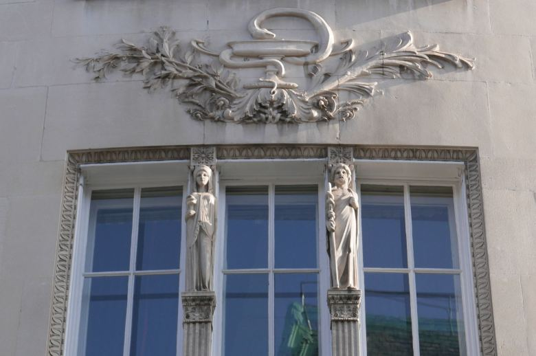 Statues and carving on front of building.