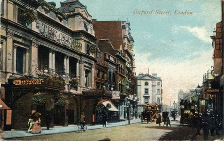 Colour-tinted postcard from 1918 showing the facade of Oxford Music Hall.