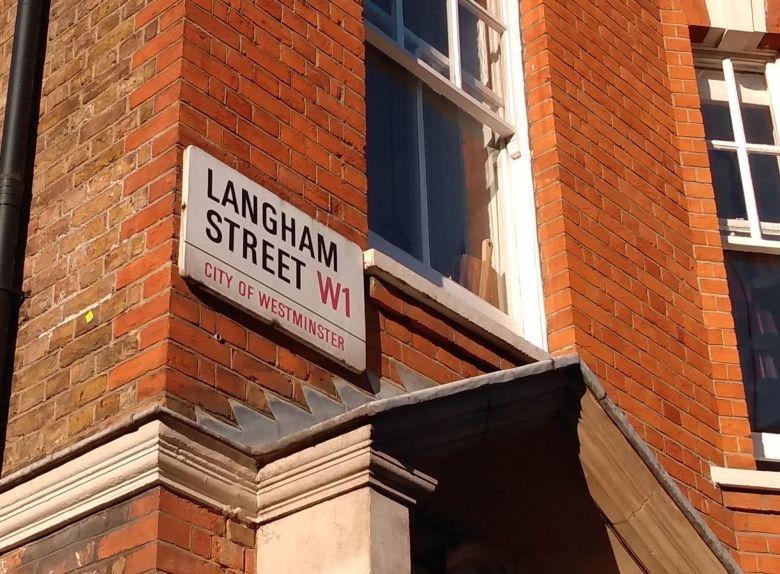 Langham Street sign on building.