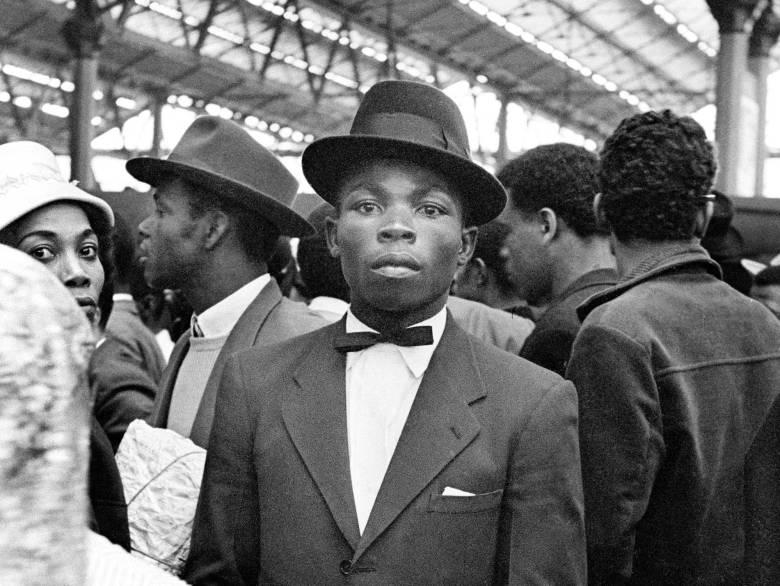Man at Waterloo Station looking at the camera.
