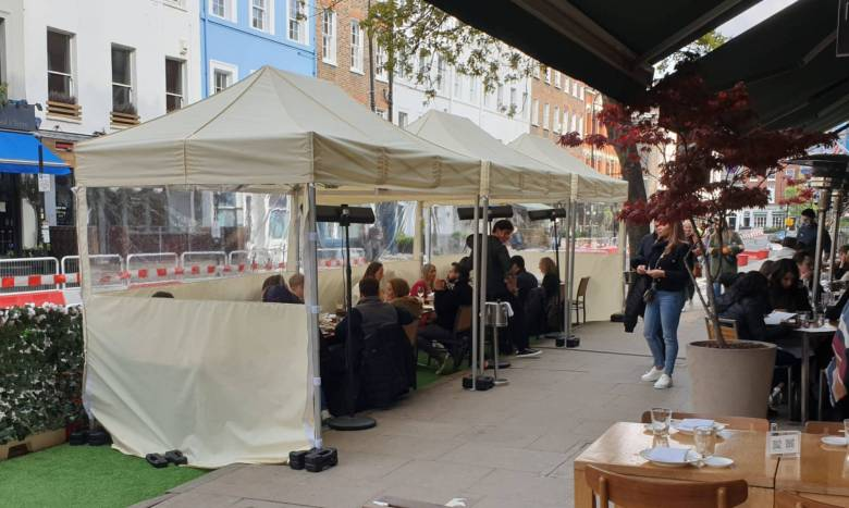 Outdoor eating and drinking in a gazebo on Charlotte Street, Fitzrovia.