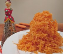 grater lady grates mountain of carrots