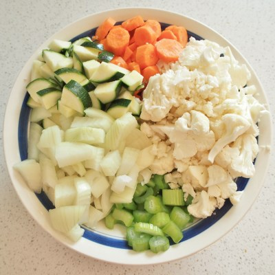 Chopped mix vegetables to add to a slow cooker full of lamb for an Indian dinner for 20