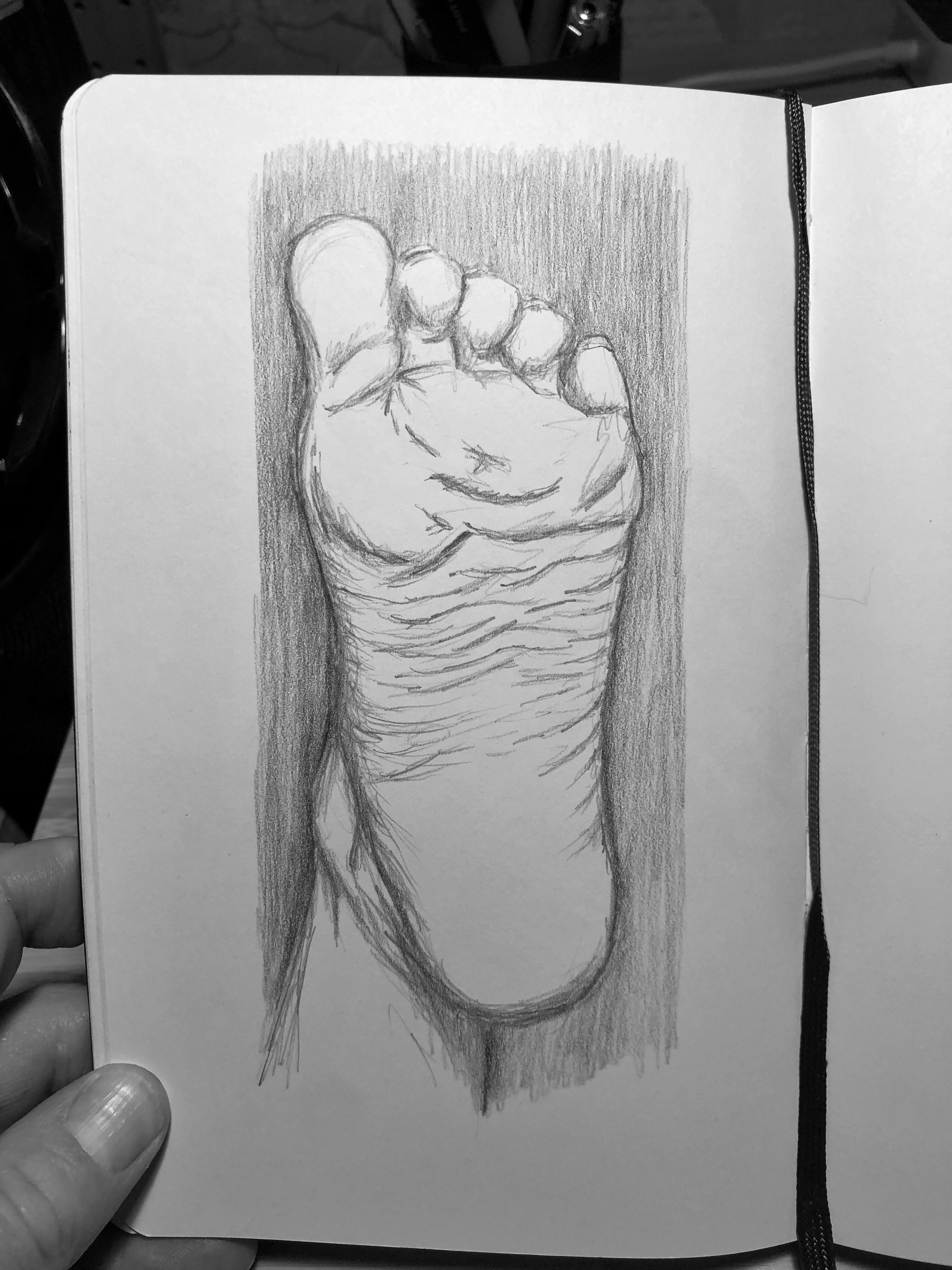 Drawing of the bottom of a foot stretched upwards in the air.