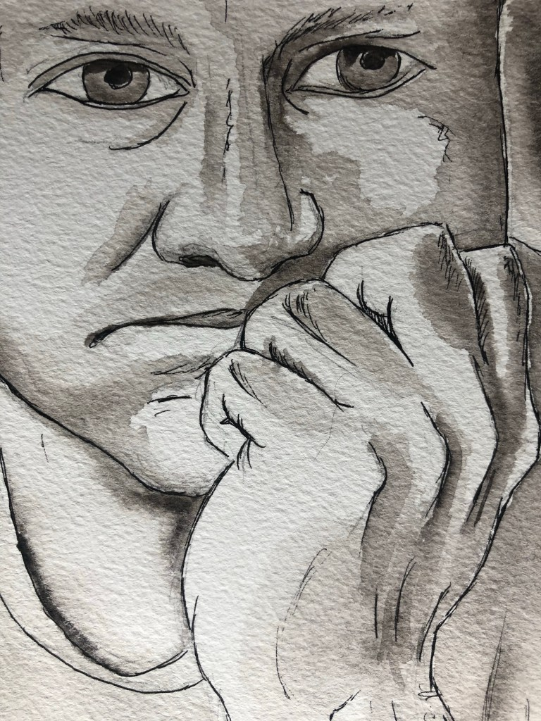 Close up of portrait of a man looking bored with face in hand.