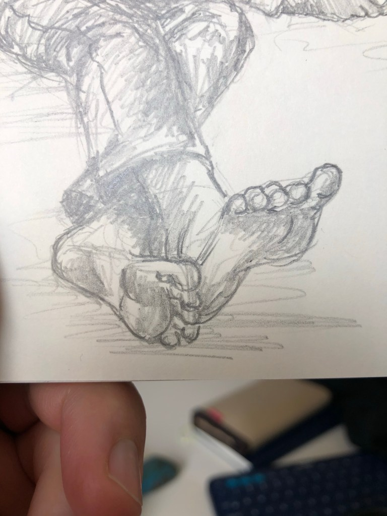 Close-up of pencil drawing of feet.