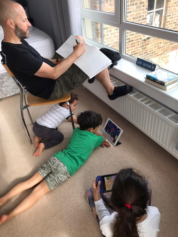 Me and the kids playing and drawing in the bedroom.