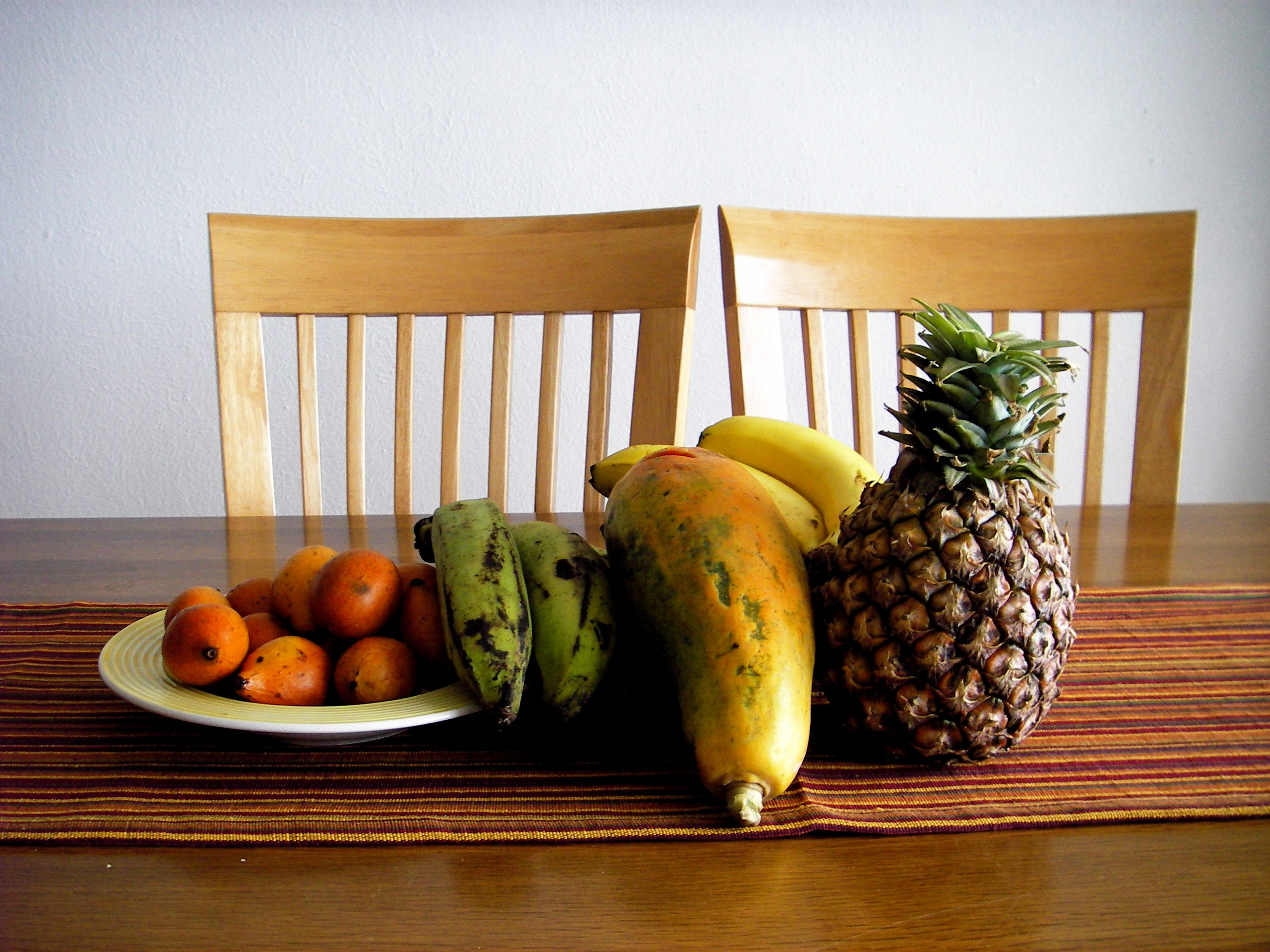 A selection of fruits fresh from the market: guamas de la india, platanos, papaya, bananas and pinapple