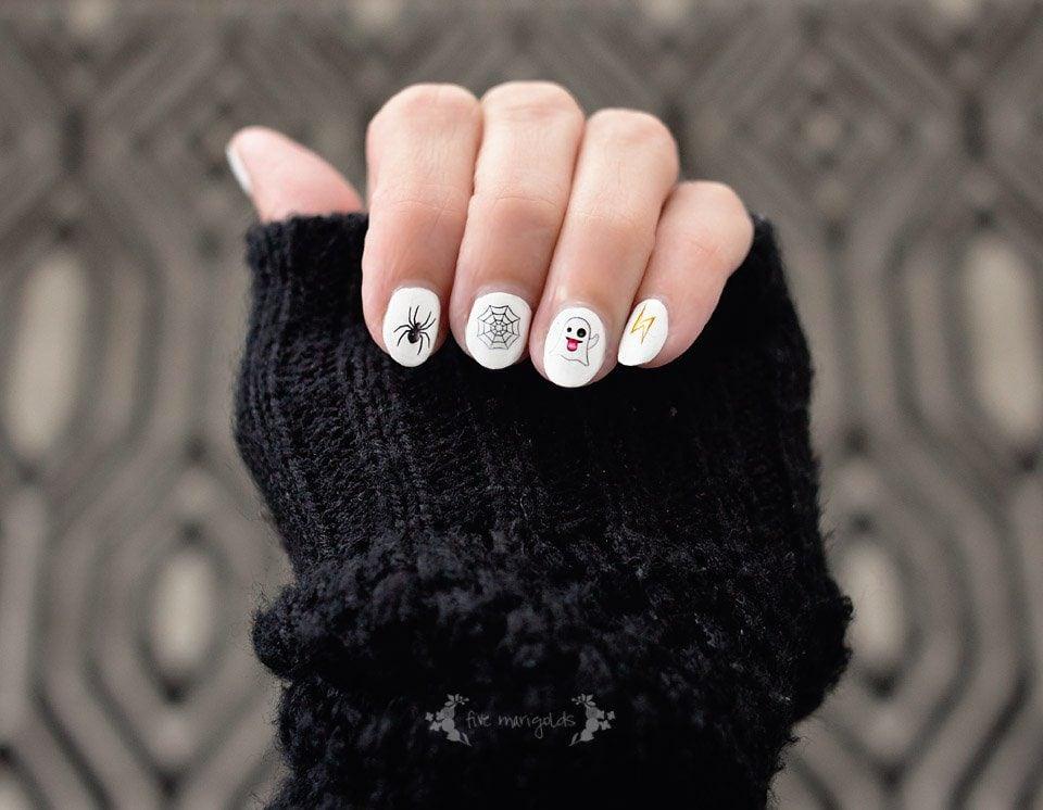 Great idea! Printable nail art using Halloween themed emojis!