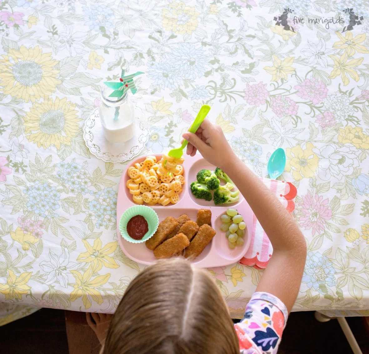 My go-to meal: Kidfresh Fun-tastic Fish Sticks and Kidfresh Wagon Wheels Mac + Cheese, served up with fresh fruit and veggies.
