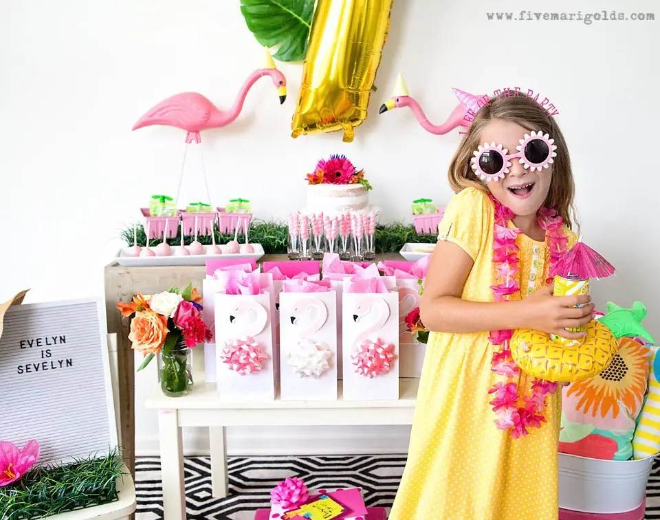 This pink flamingo pool party is adorable! Love the idea for favor bags.