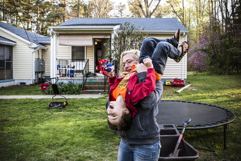 Fawn Ricciuti, 33, plays with her son Aiden, 5, in the yard of her home outside of Richmond, Virginia.