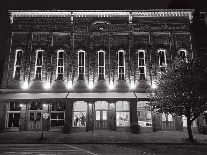 Stuart's Opera House lit up at night