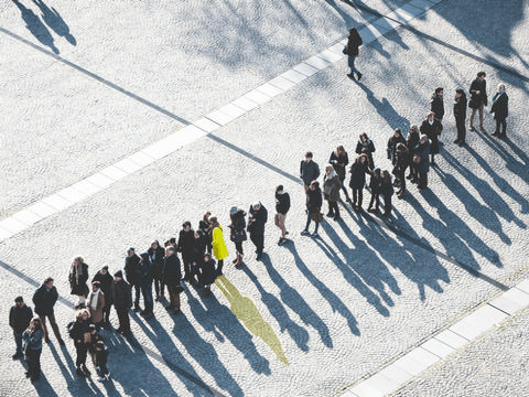 Image of line of people illustrating the power of persuasion of using influencer marketing for SaaS