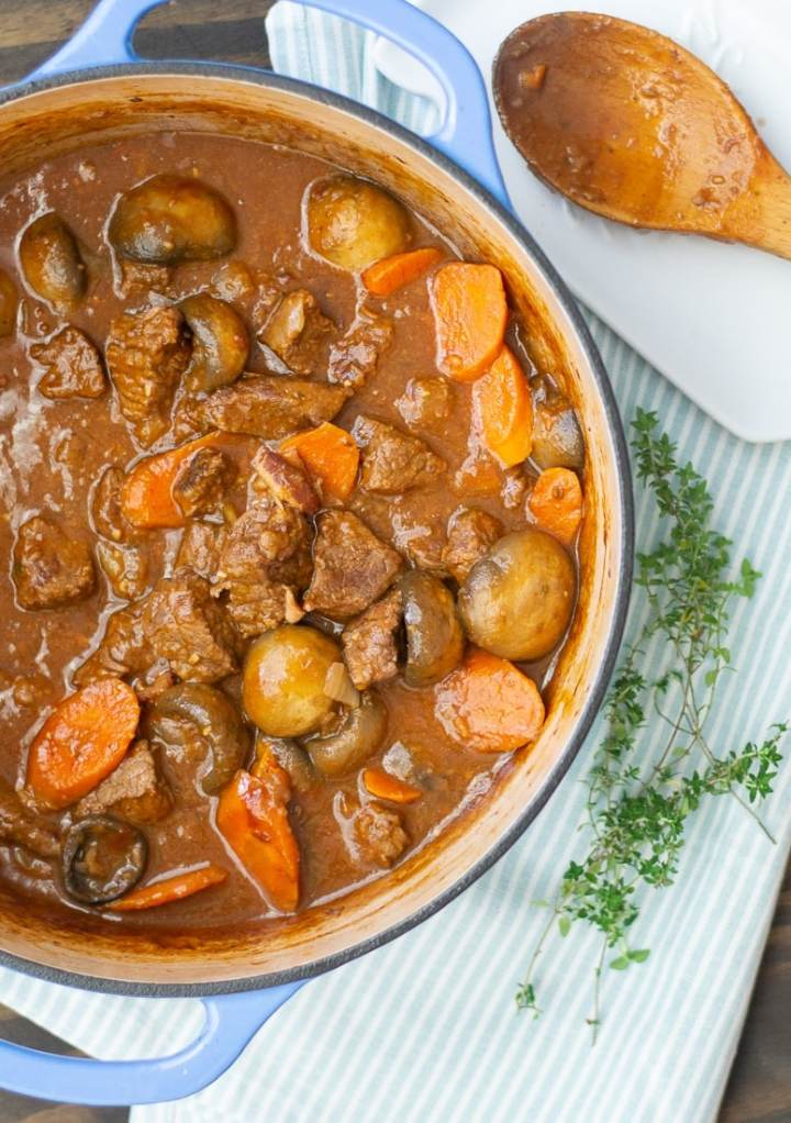 Beef Burgundy or Beef Bourguignon is a healthy, grain free one pot hearty dinner for the family. This beef burgundy recipe is loaded with lots of beef and vegetables in a red wine sauce that makes it the perfect comfort food. #fallrecipe #beefdinner