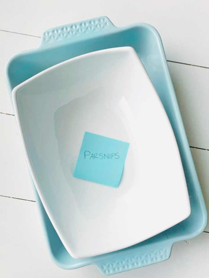 Write down the name of each recipe you're making on a sticky note. Place the appropriate sticky notes inside the dishes that recipe will go in.