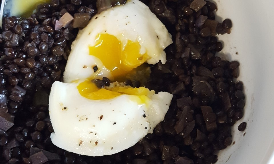 black lentil bowl with poached egg