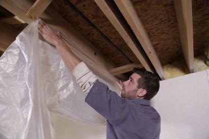 Crew installing basement waterproofing solutions