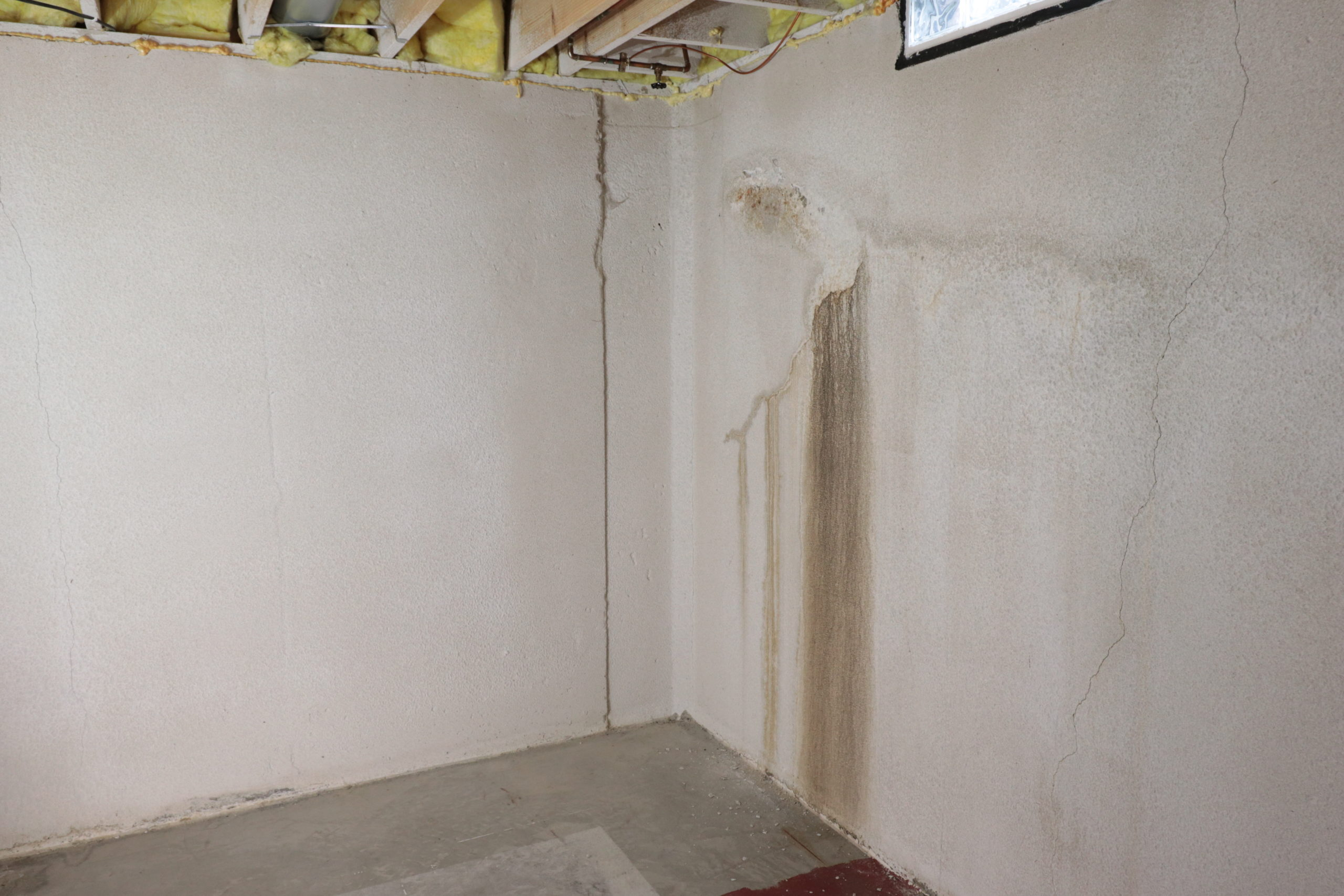 water stains on interior walls of basement