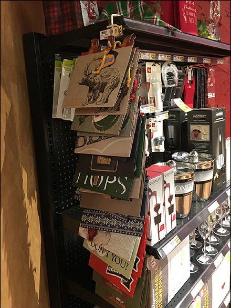 beer gift bags sold by strip merchandiser fixtures close up