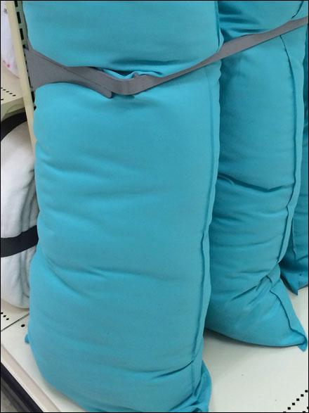 Body Pillows in a Space Frame  Fixtures Close Up RetailPOP