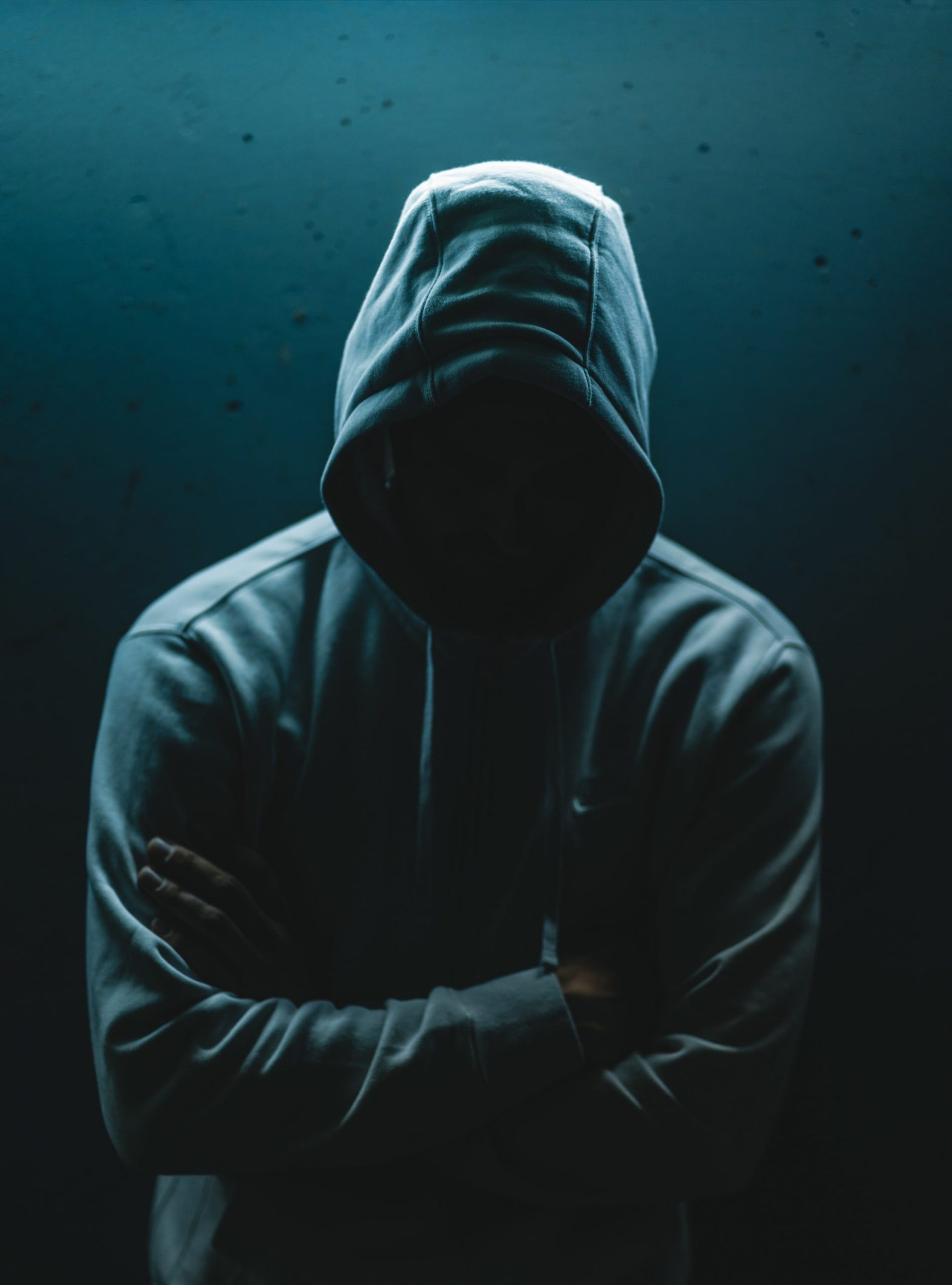 Man wearing hoodie so you can't see his face: De-selfed.
