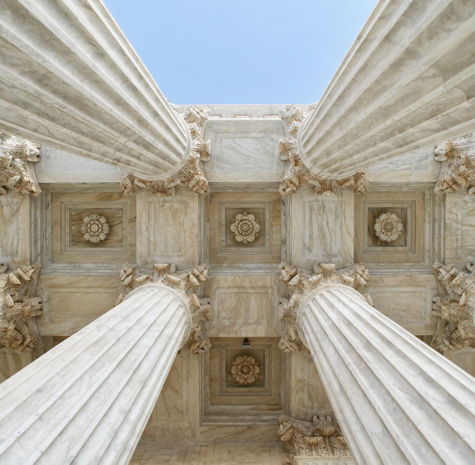 View looking up at 4 cement pillars – The 4 Pillars of Healing and Growth