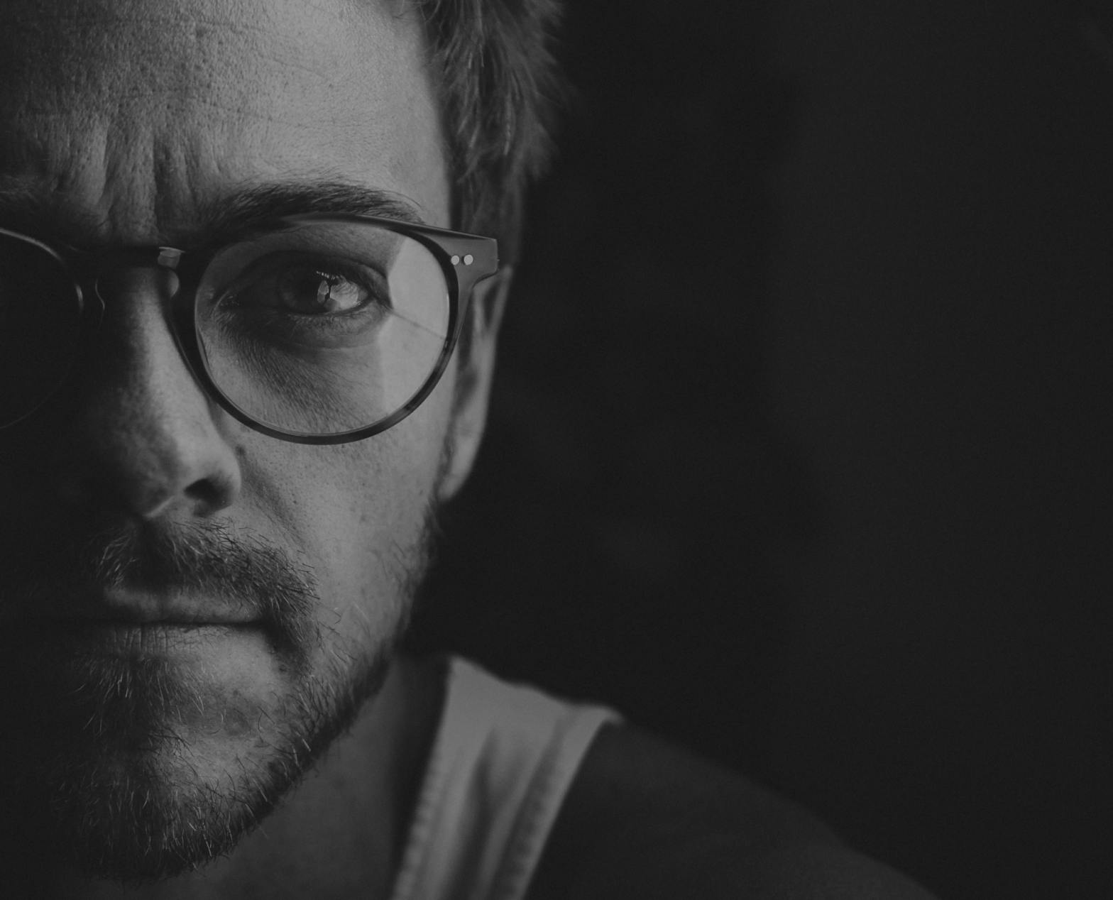 Black and white photo of a man's face–attachment, authenticity, trauma, addiction, recovery