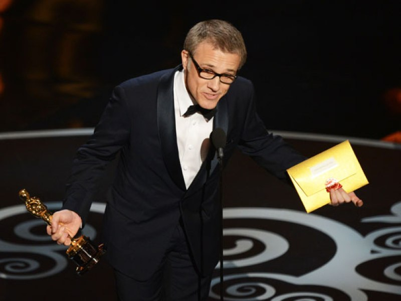 Best Supporting Actor Christoph Waltz accepts the trophy onstage. —Photo by AFP