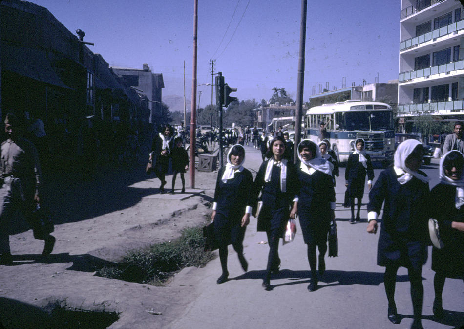 Afghan girls coming home from school. Both Afghan boys and girls were educated until the high school level.