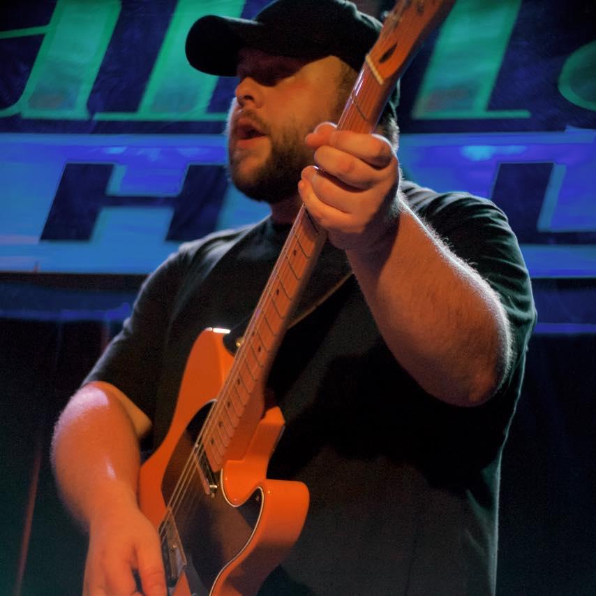 Jordan Denton playing guitar