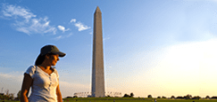 woman standing in front of the Washington monument