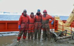 In our muddy Mustang suits after processing a trawl. Photo credit: M. Lewis.