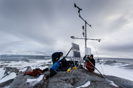 Useful Island automated weather station being serviced by U. of Alaska scientists. The weather station was set up in December 2015 and has since been providing meteorological data. A digital camera powered by a solar panel array takes one picture every 15 minutes. The team downloaded 11,000 images on this excursion, representing four months of visual data. The camera captures the movement of icebergs and sea ice which will help the scientist understand ocean circulation and ice flux in and out of Andvord fjord on the western side of the Antarctic Peninsula. The weather station will now record data and images for a full year until it is recovered in May 2017. Photo by Maria Stenzel
