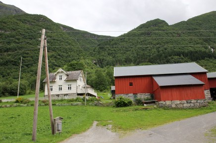 The tractor road starts behind this farm
