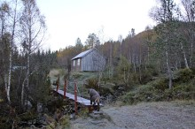 The forest path begins by this cabin