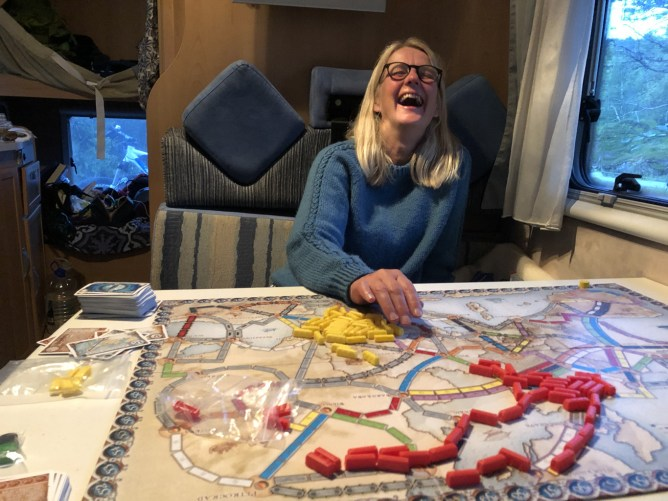 Anne, losing a game of Ticket to Ride with a smile...