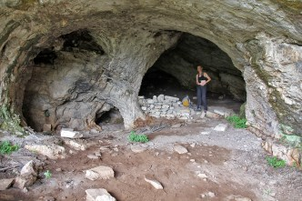 A big cave, with a huge window further in