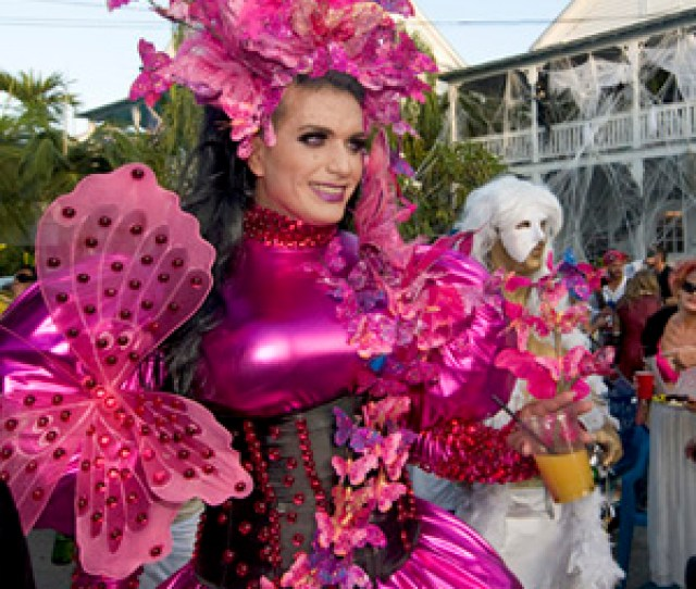 Elaborately Costumed Revelers Proceed Down Fleming Street In Key West During The  Fantasy Fest Masquerade