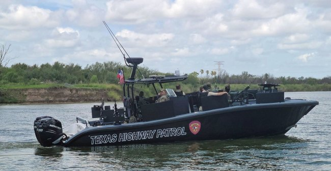 TX DPS/Highway Patrol boat on the Rio Grande River. Mexico in the background. Note the five .50 caliber machine guns and armor plating for protection from the drug cartels.