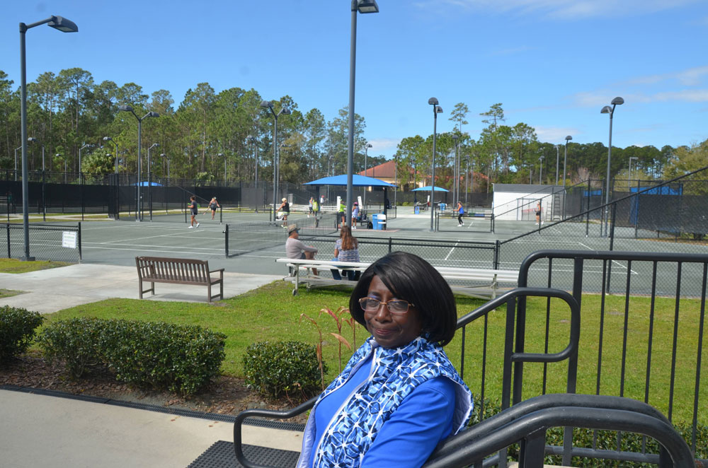Agnes Lightfoot, long an advocate of the Palm Coast Tennis Center, was on her home grounds this morning soon after attending a City Council workshop where plans for a vast expansion of the center were unveiled. (© FlaglerLive)