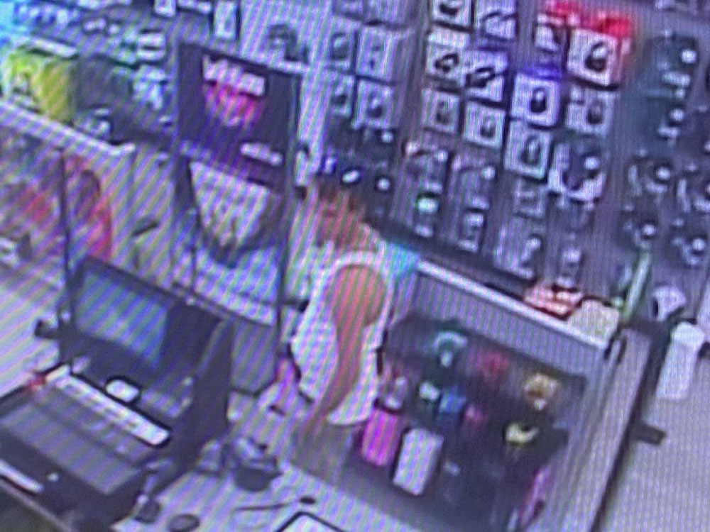 The assailant in a surveillance video capture at the store.  (FCSO)