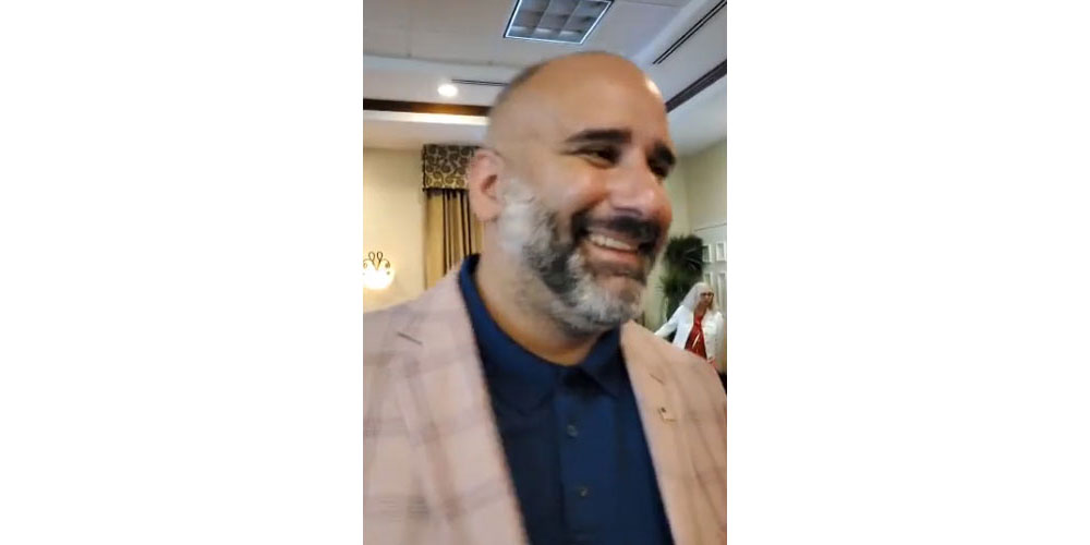 Victor Barbosa at Alan Lowe's election-night party at the Hilton Garden Inn, in a still from a video posted on Facebook.
