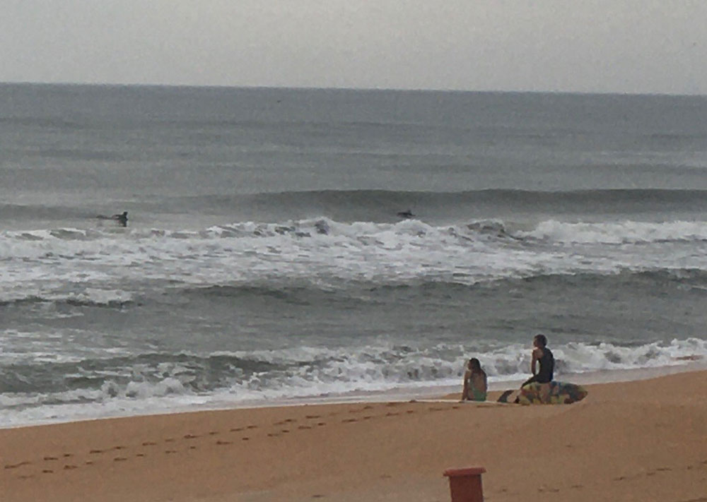 Beach-goers defying the orders to stay off the beach this morning just north of the Flagler Beach city limit. (© FlaglerLive)