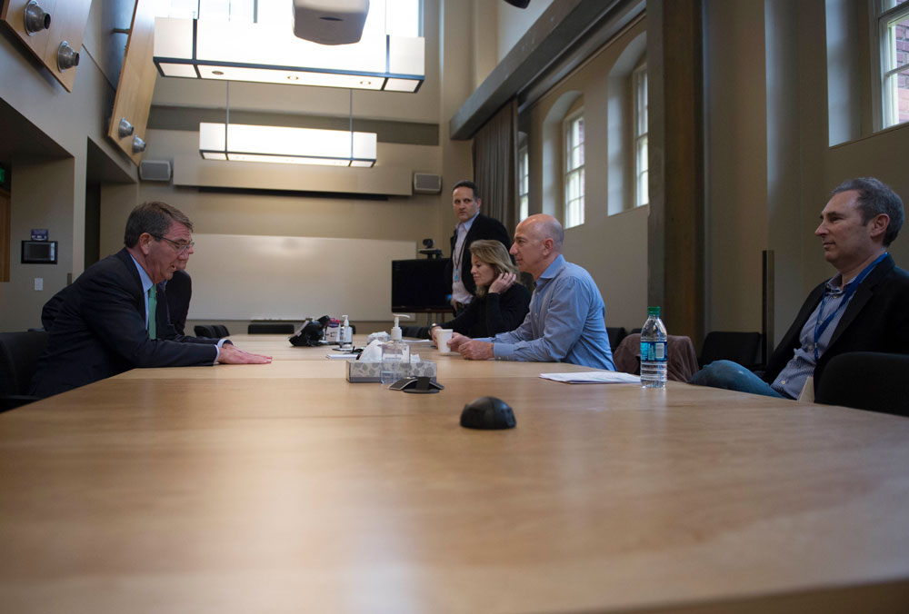 Jeff Bezos, the world's richest man, in the light blue shirt, meeting with then Secretary of Defense Ash Carter in 2016. (Department of Defense)