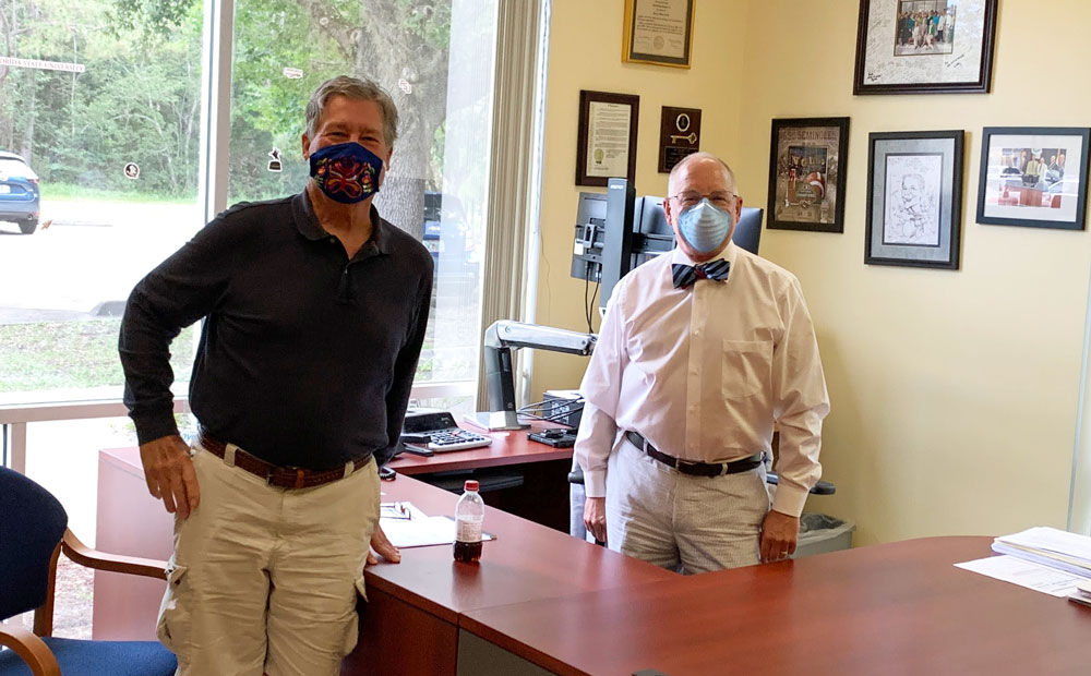 Dr. Stephen Bickel, left, the medical director at the Flagler and Volusia health departments, and Bob Snyder, who heads the Flagler Health Department, a branch of state government. (© FlaglerLive)