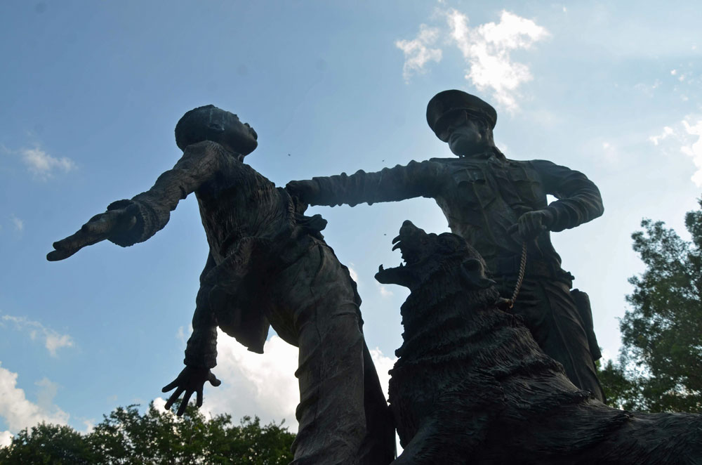 """Outside the Birmingham Civil Rights Institute, a set of sculptures at Kelly Ingram Park recreate the violence of Public Safety Commissioner Eugene """"Bull"""" Connor's attacks on civil rights protesters. (© Pierre Tristam/FlaglerLive)"""