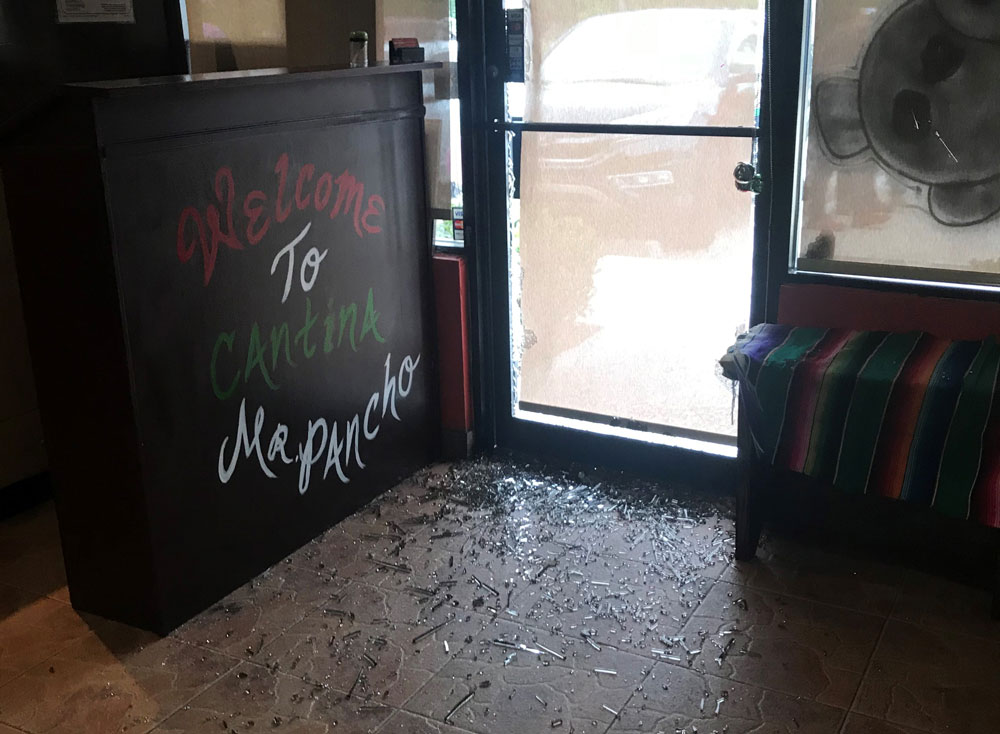 The burglars in both cases entered the restaurants by smashing the lower window on the front door. (FCSO)