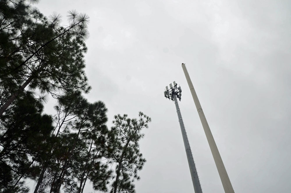The new cell tower behind the Palm Coast Tennis Center is on the left, next to an existing, but less effective, tower. (© FlaglerLive)