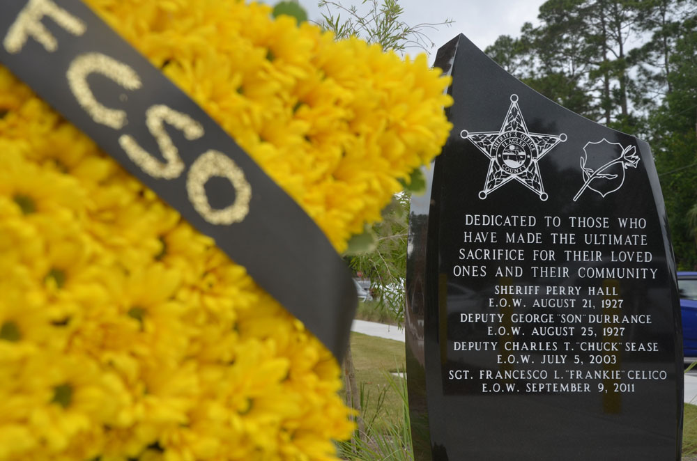 Deputy Charles Sease's name is one of five law enforcement officers' names engraved on the Flagler County Sheriff's memorial to the fallen, and the last officer to die from a hostile act in Flagler, in 2003. (© FlaglerLive)